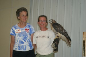 Glenda Sellers(L) nominated S.O.A.R. Raptor Recovery Center for a Wildlife Grant. Linette Bernard (R) with Bella.